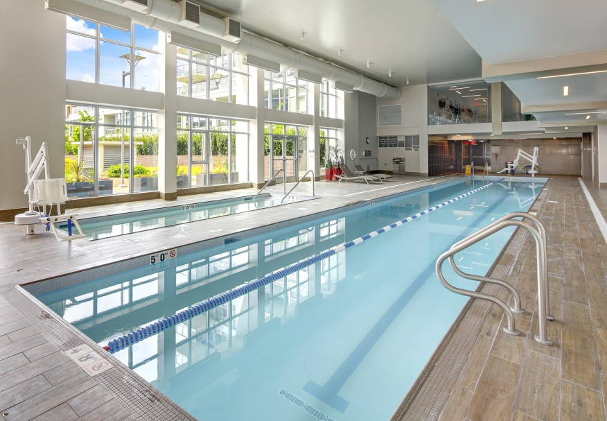 View of indoor swimming pool in luxurious apartment building. Northwest, USA