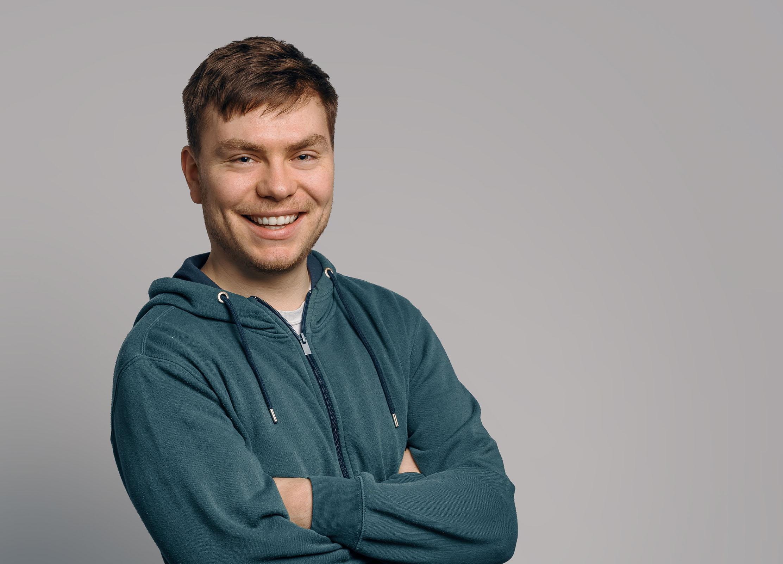 Man in sweatshirt smiling