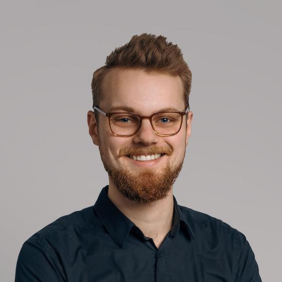 Man with facial hair smiling