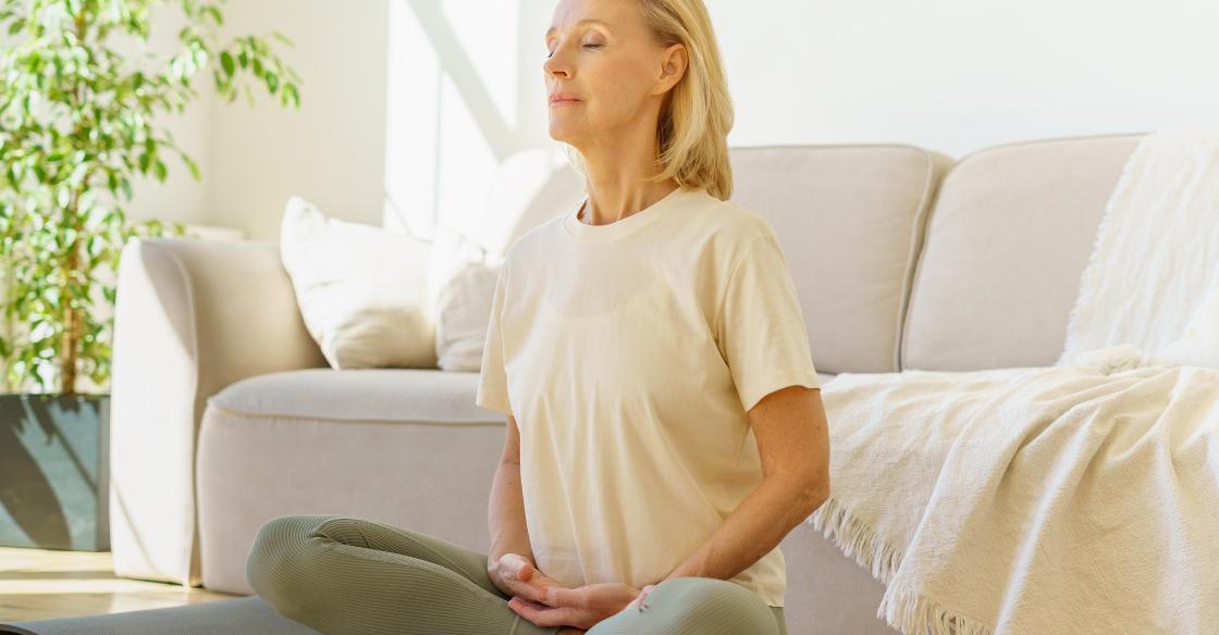 Woman doing breathwork after yoga