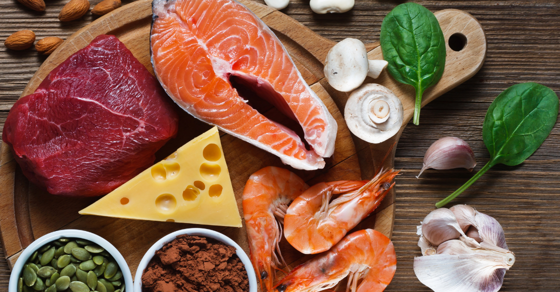 Flat lay of foods rich in zinc like red meat and salmon
