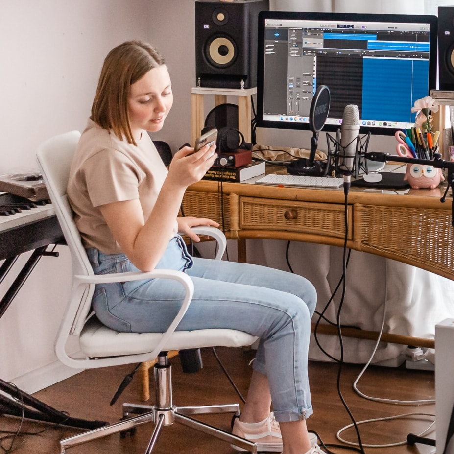 Woman at her podcast studio