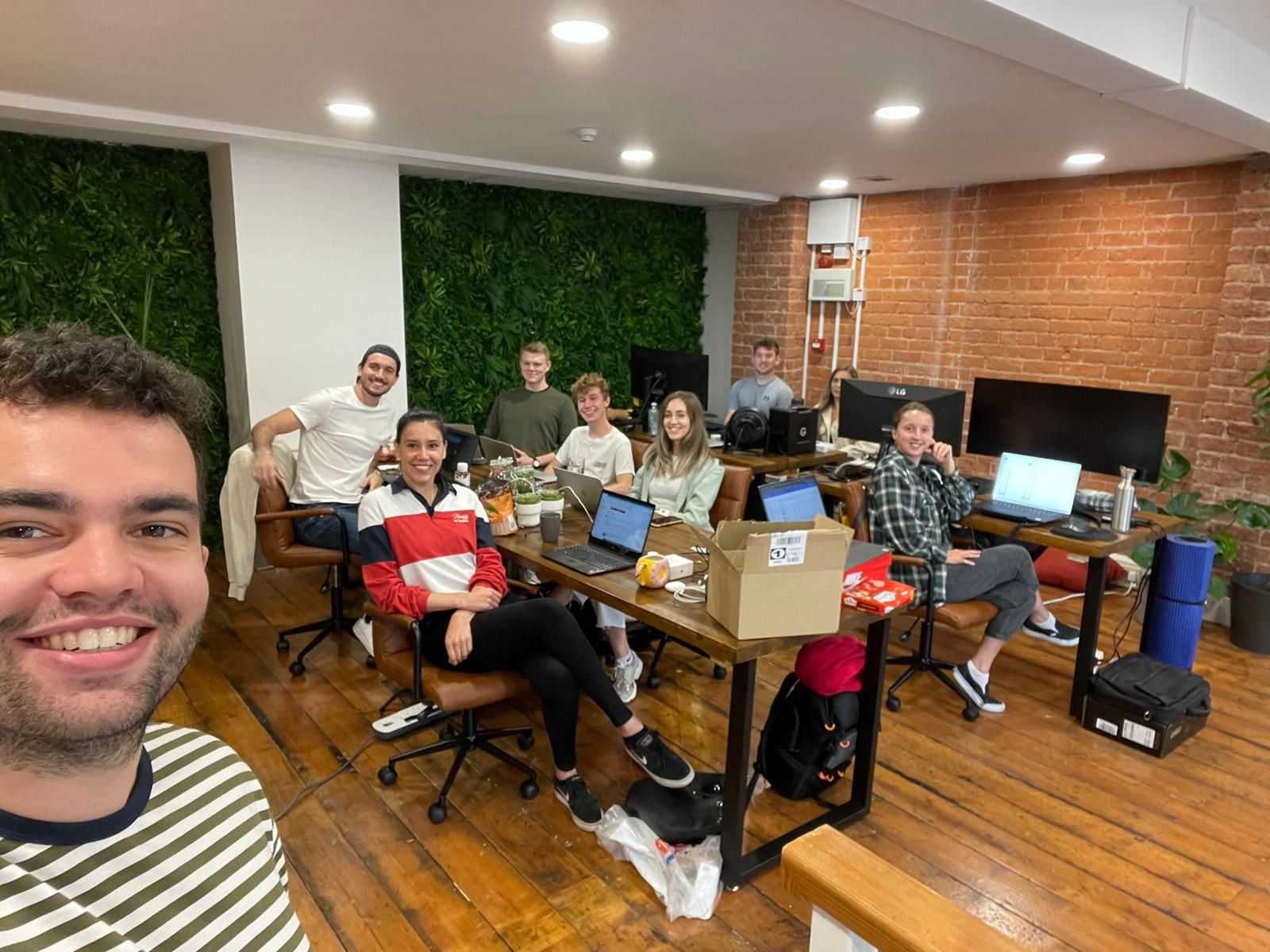 Picture of the team sitting in the new office at computers.