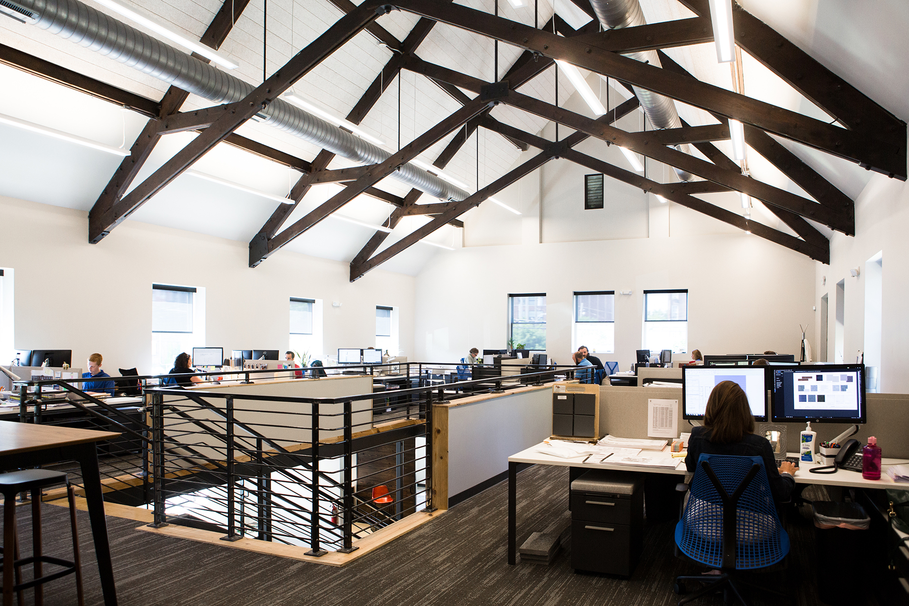 archall office work space with vaulted ceilings, open space and commercial function.
