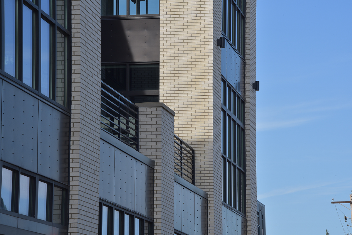 close-up shot of a second-story patio on a building archall was the architect for.