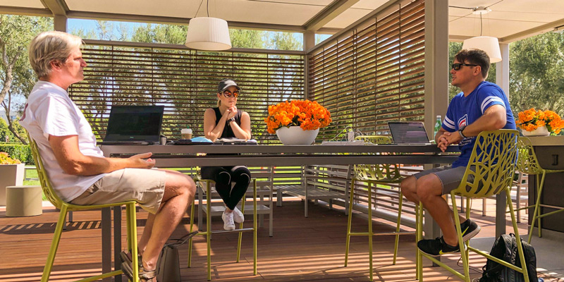 Dreamhaven employees having an outdoor conversation