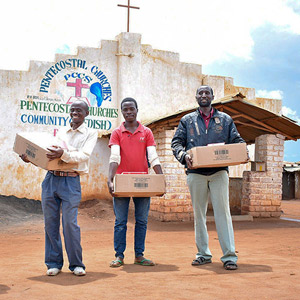 Delivery of supplies to a refugee church in Malawi