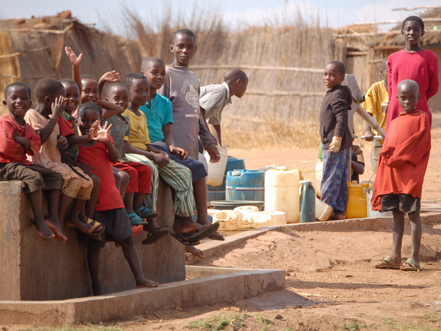 Children at a well in Dzaleka camp