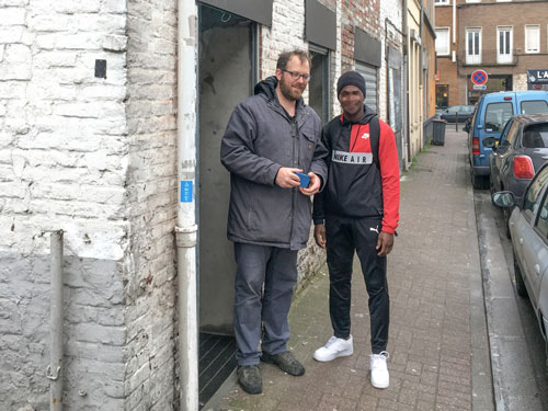 Michael Jurrens meets a refugee outside of the Lille Ministry Centre