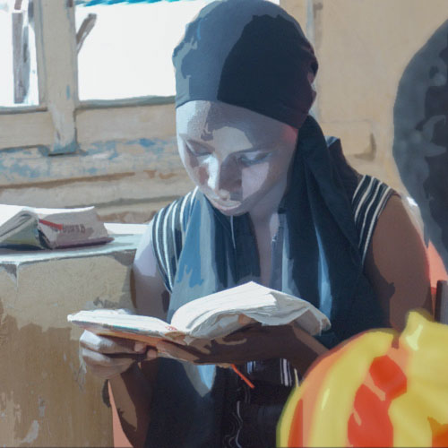 A girl reads her Bible during the annual Refugee Youth Camp in Kakuma, Kenya