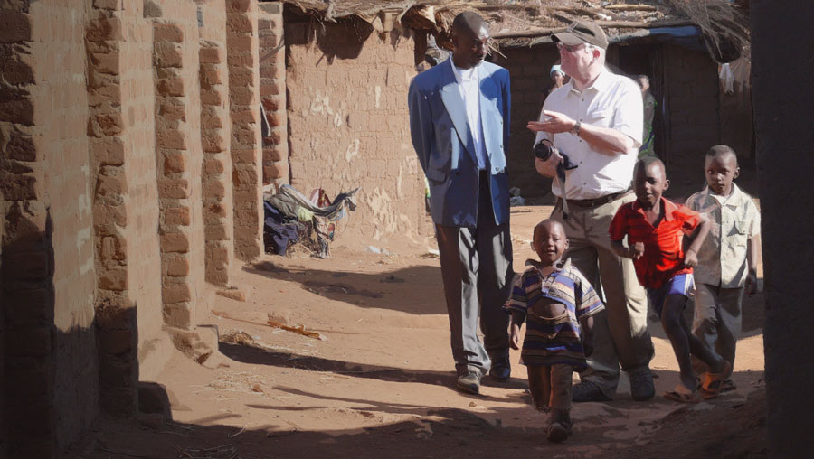 Tom Albinson with a refugee pastor in Dzaleka refugee camp, Malawi