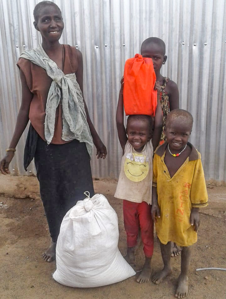 refugee church leaders pick up the resources to turn their churches into soap distribution centres in Kakuma