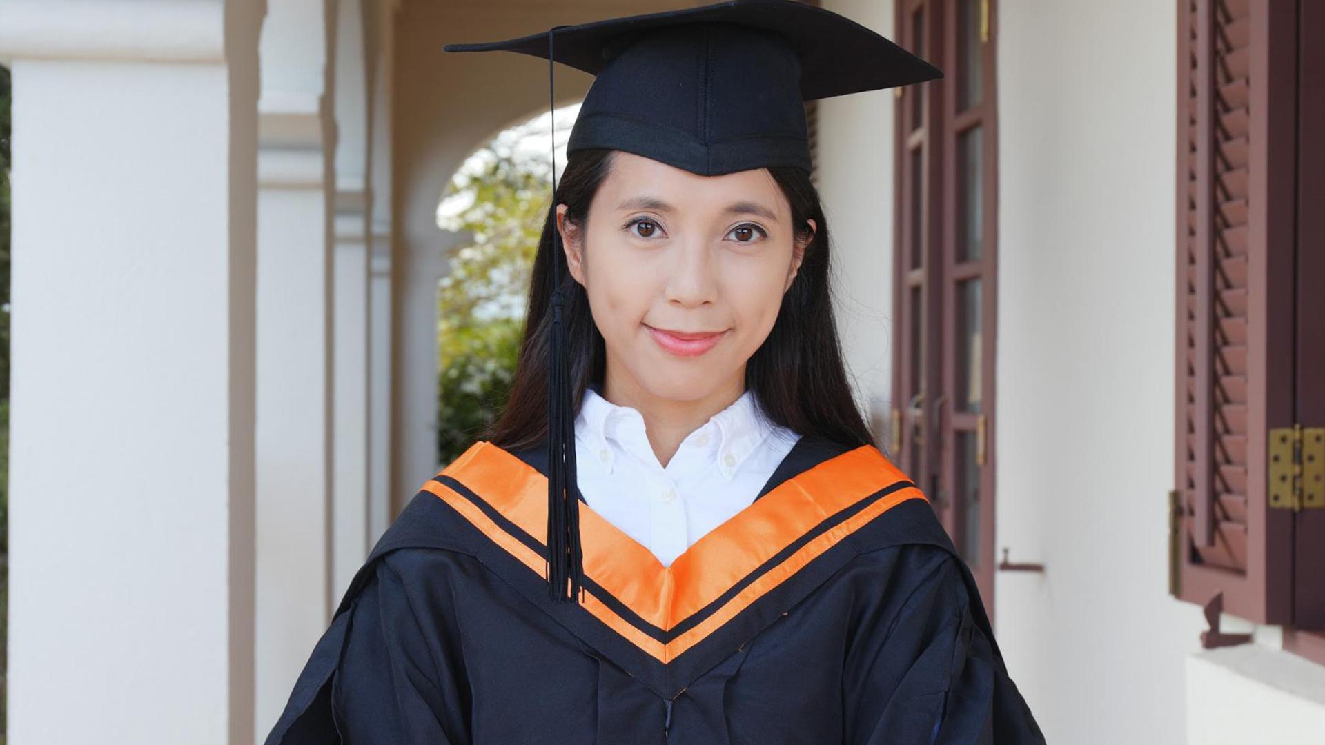 A graduate smiling