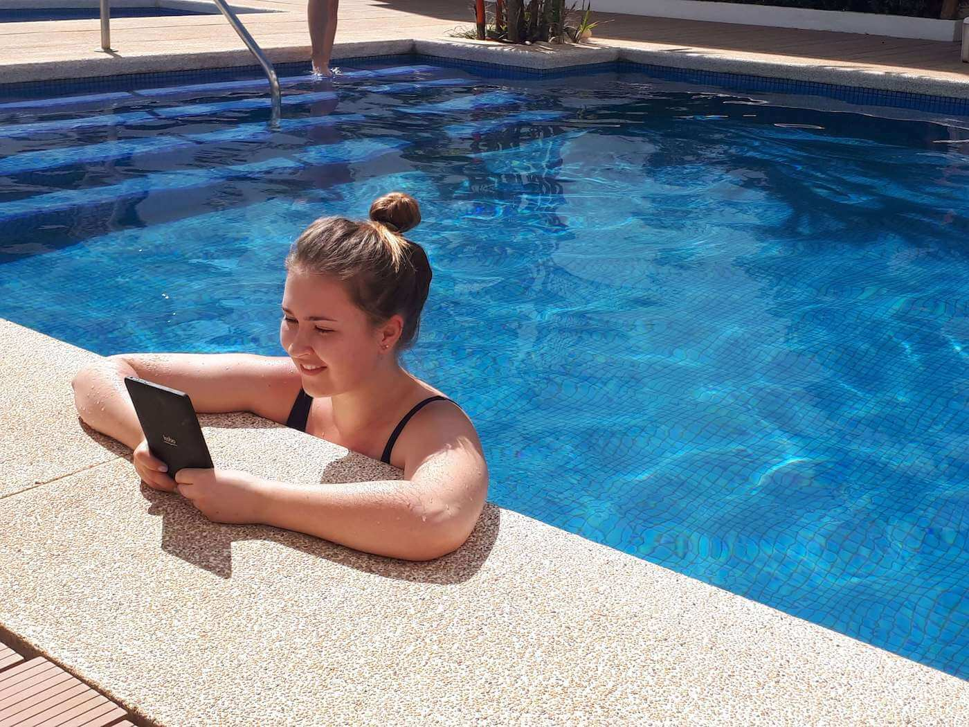 person using phone in swimming pool