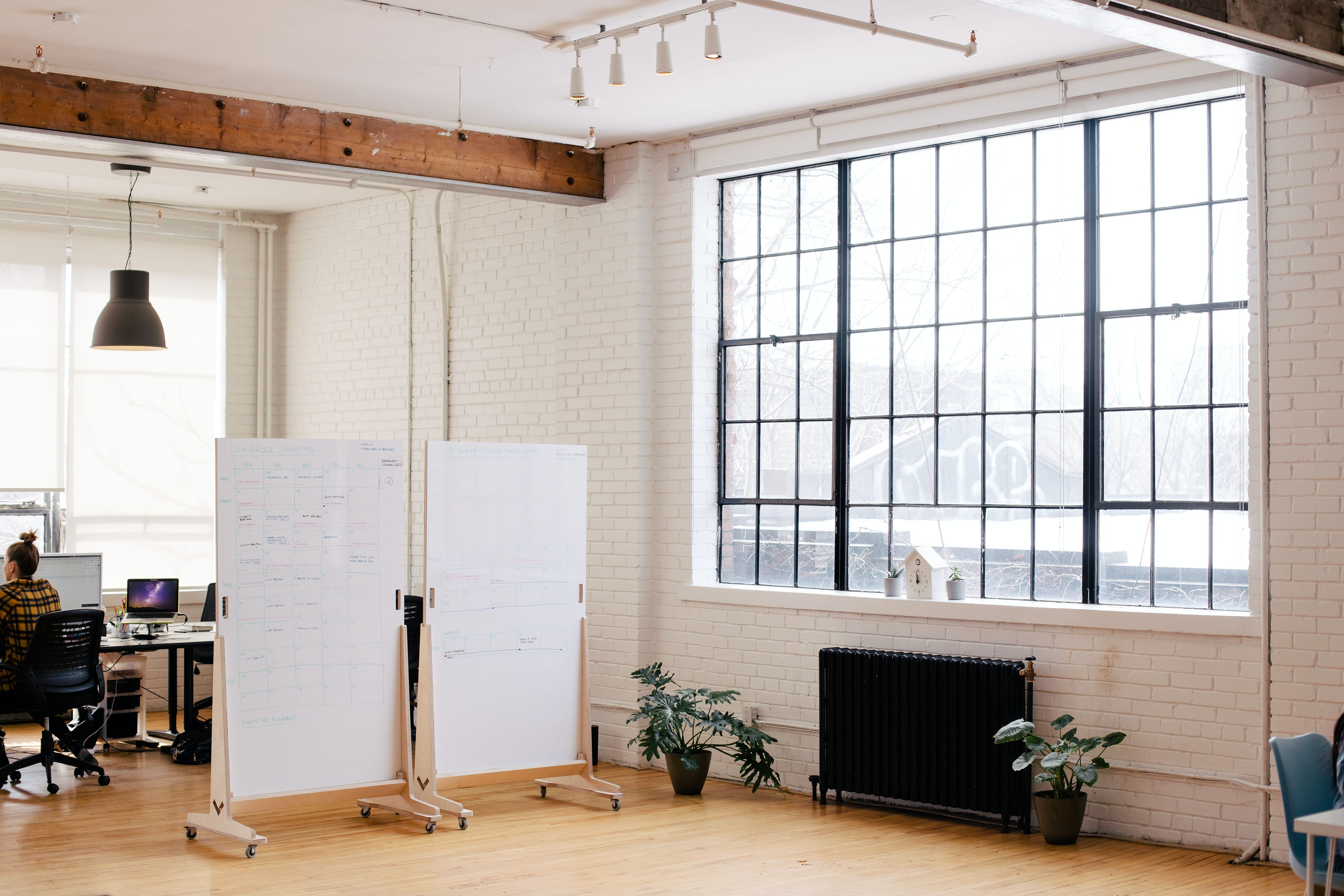 Well lit room with white boards and windows
