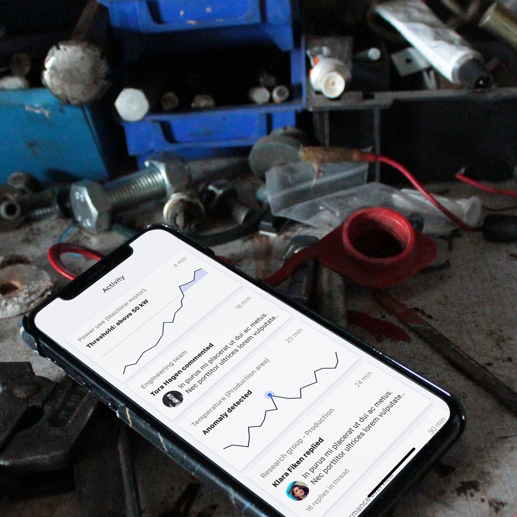 Clarify app interface displaying anomaly detection on iPhone at messy industrial desk
