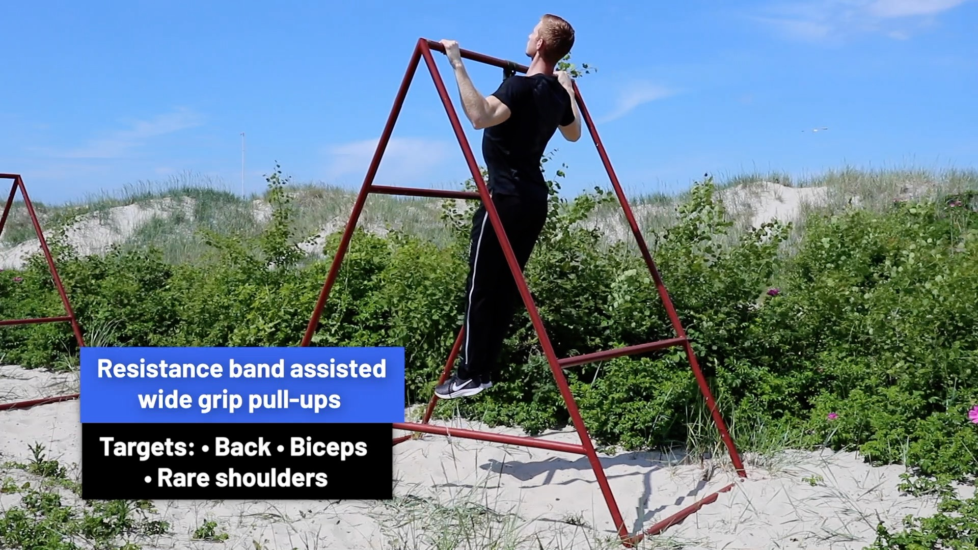 Resistance band assisted wide grip pull-ups