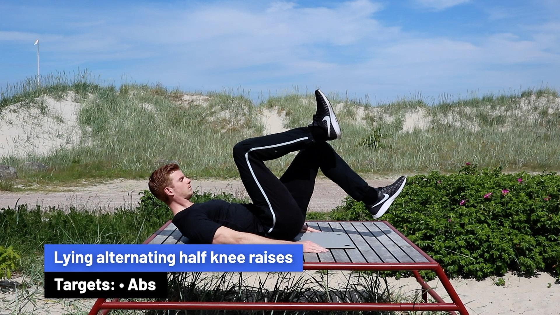 Lying alternating half knee raises