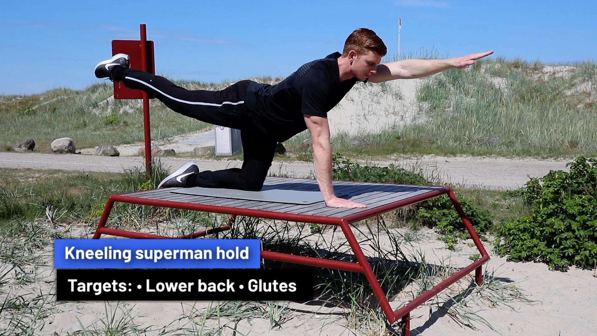Kneeling superman hold