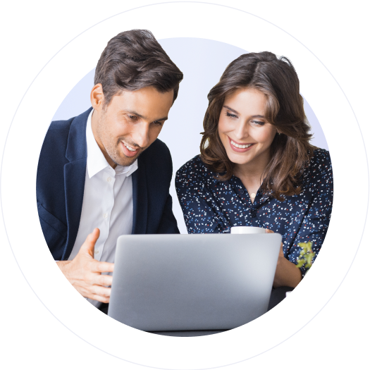 male and female adult in discussion review work on laptop