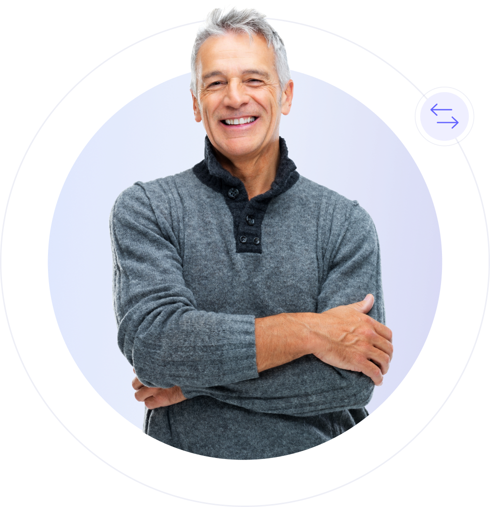 middle aged male financial advisor smiling arms crossed