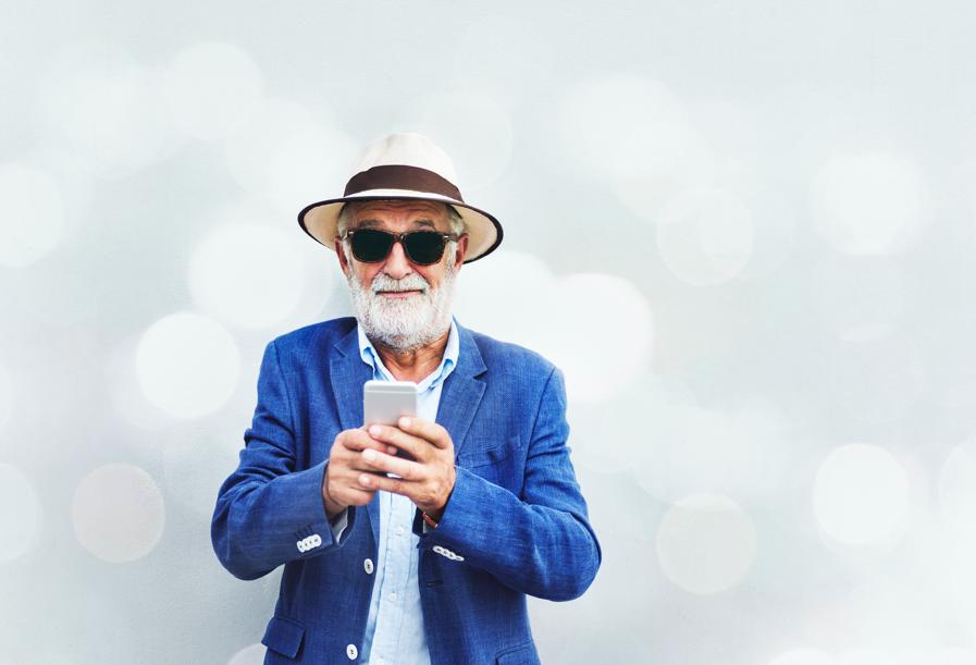 Senior man checks cell phone uncertainly