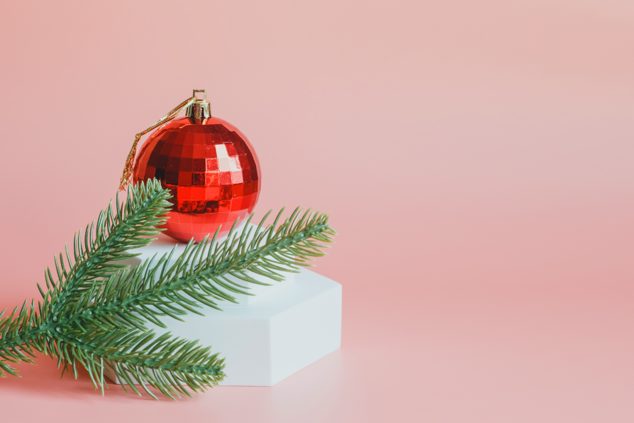Holiday ornament beside Douglas Fir Christmas tree clippings
