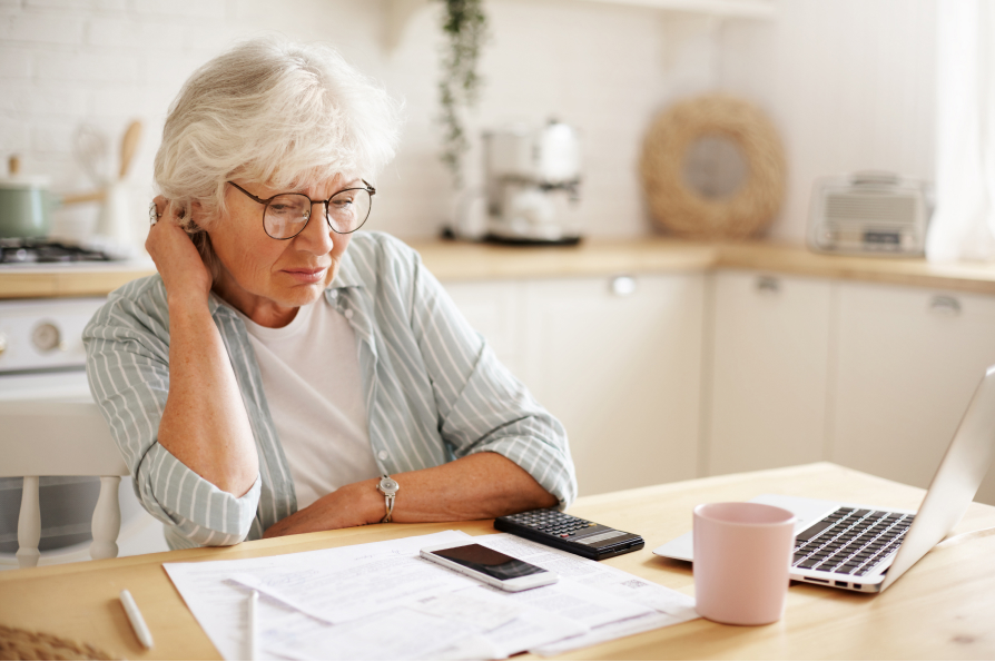 middled aged female pensive learning estate planning types of wills