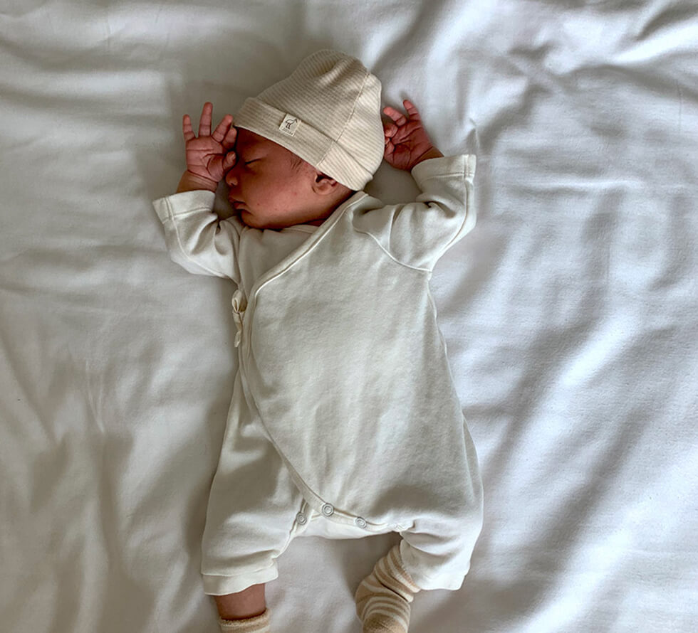 Baby lying on a bed
