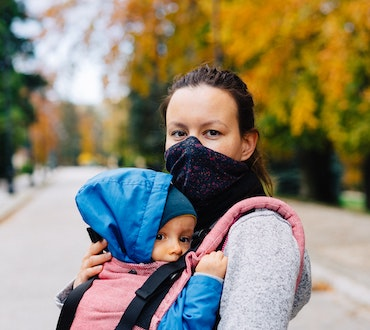 Mother with baby in baby carrier