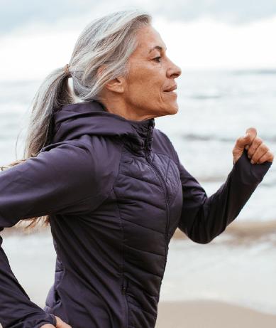 Mature woman running on the beach