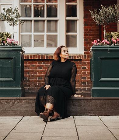 Woman sitting on stoop