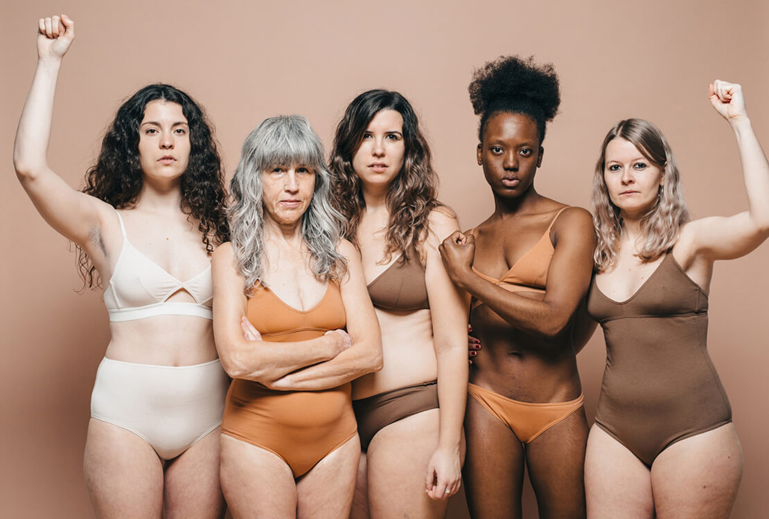 Five confident healthy women in underwear