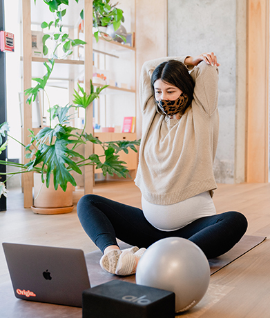 Pregnant woman doing virtual physical therapy