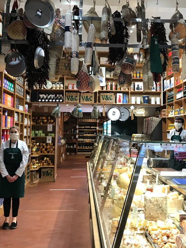 Inside Valvona and Crolla: hanging meat and a cheese counter