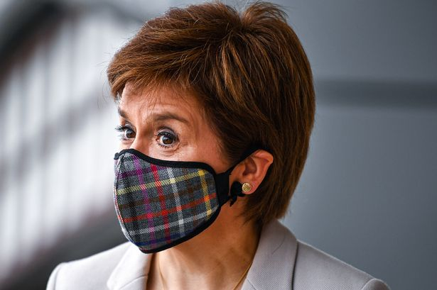 Nicola Sturgeon in Slanj face mask