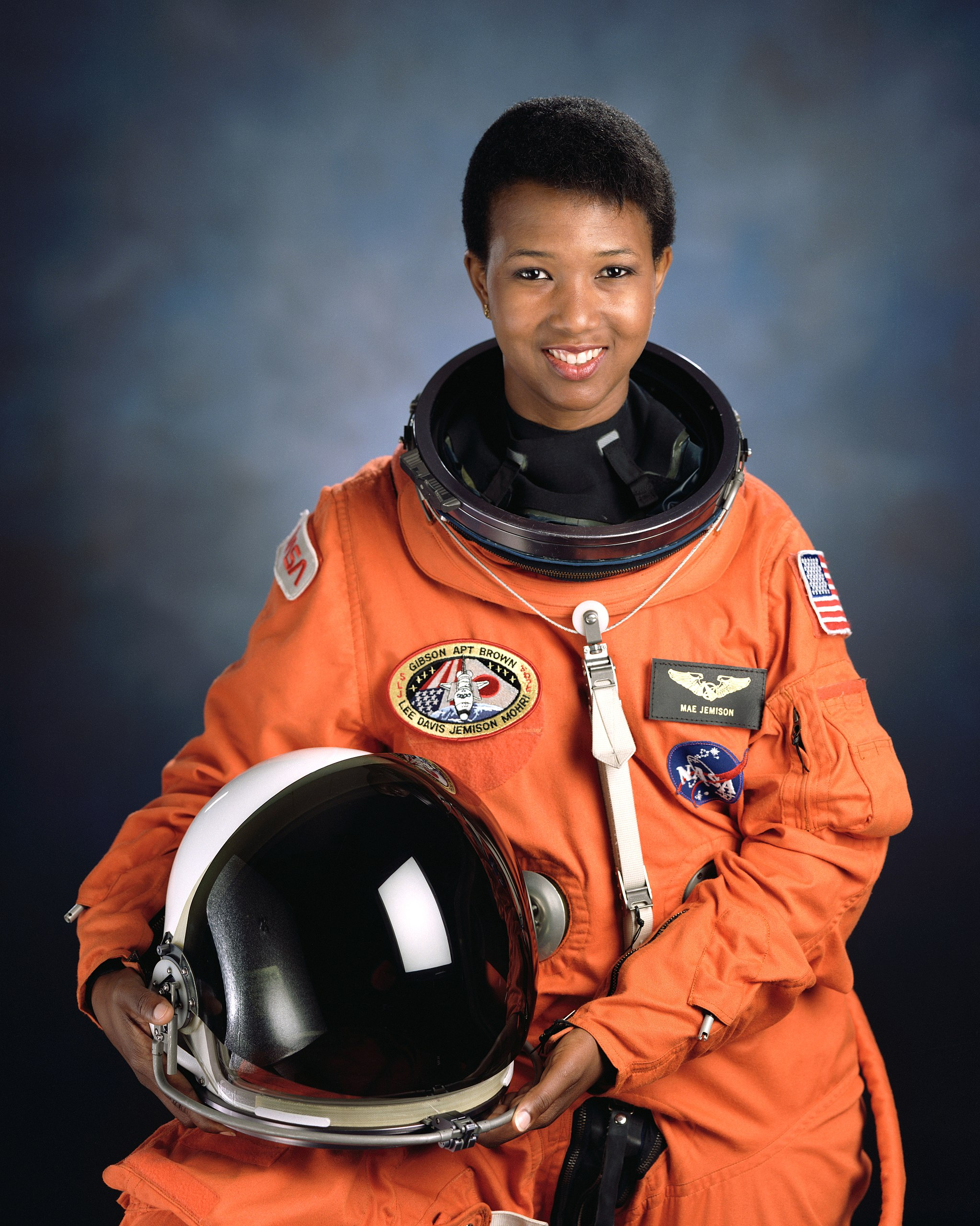 Mae Jemison in orange NASA astronaut spacesuit