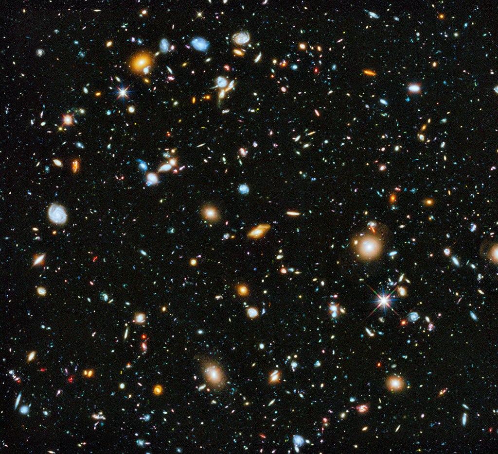 lots of planets, stars and other matter representing the universe