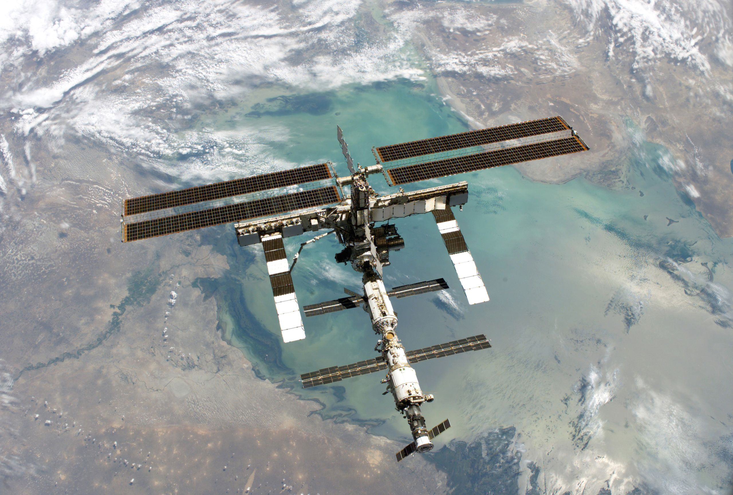 The ISS pictured from above, it looks down to the earth and sea below