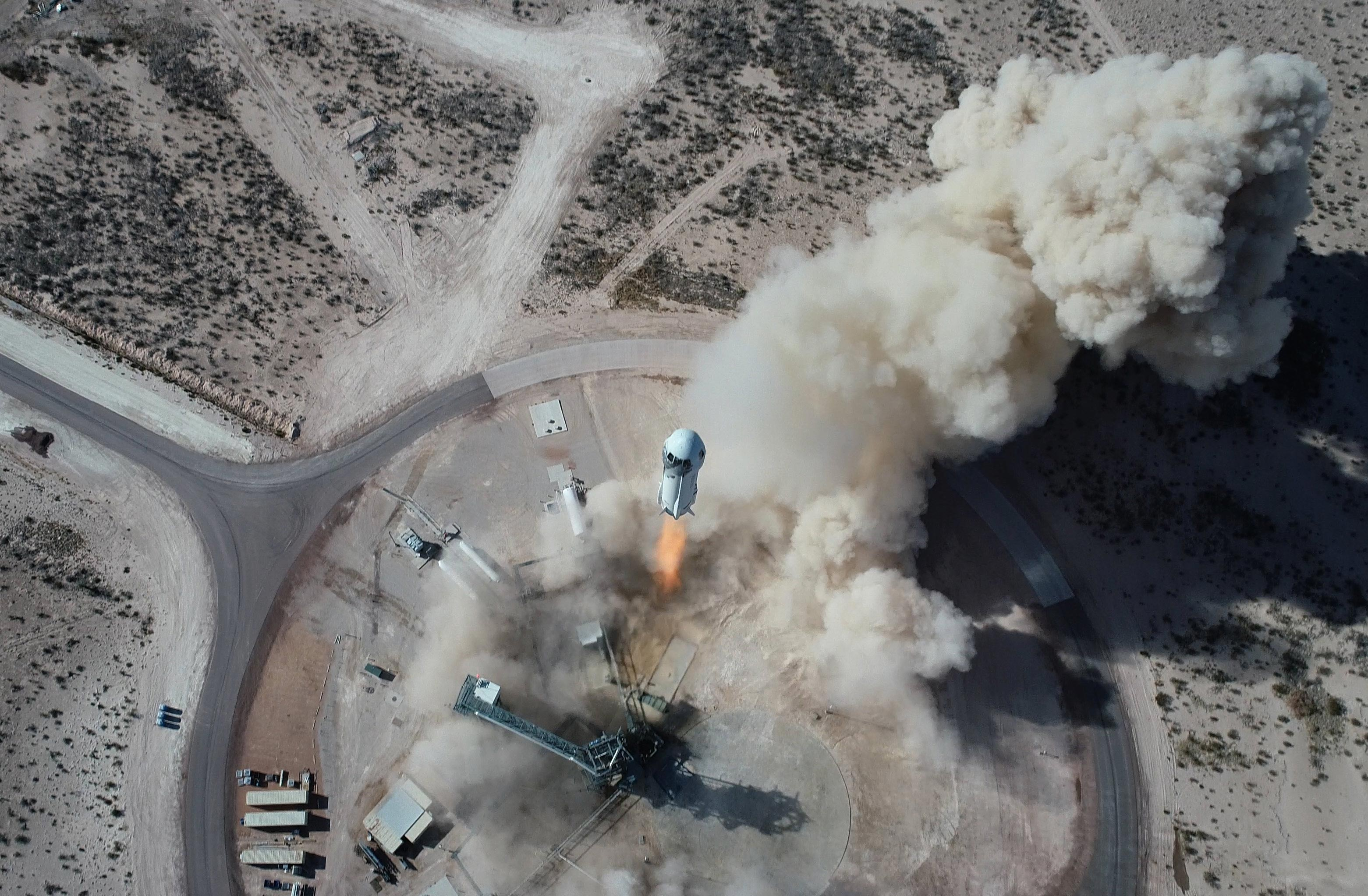 Launch of New Sheppard pictured from above, the rocket central with a large flame