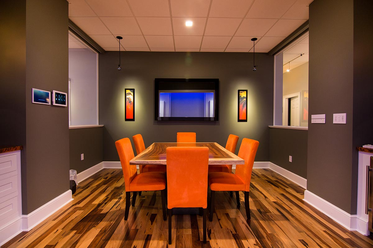 RMS conference room with integrated TV and art speakers