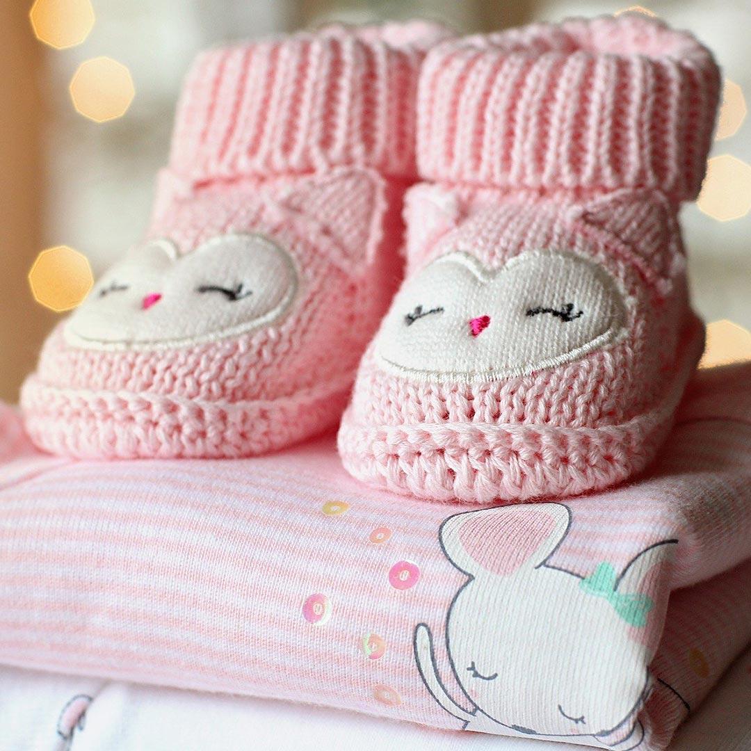 Какую детскую одежду ипелёнки для новорожденного лучше купить