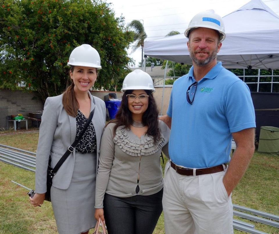 Tara Hammond met Assembly member Lorena Gonzalez's team member Aida Castaneda at a GRID Alternatives San Diego installation with GRID San Diego's executive director, Paul Clearly. May 2016.