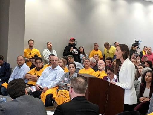 Tara Hammond speaking at a California State License Board hearing, advocating that electricians should install energy storage paired with rooftop solar.