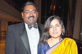 Raj Rajaratnam, at left.