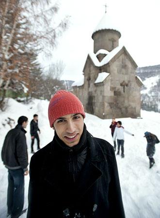 Robert Urutyan and fellow students take a snow break.