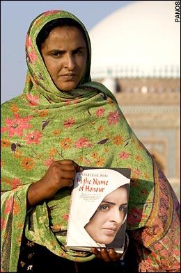 Muktar Mai, holding a copy of her 2007 book.