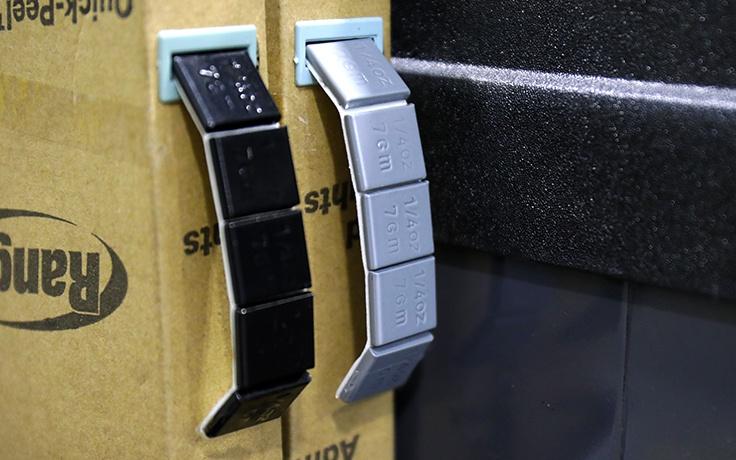 Wheel balancer tape weight feeder