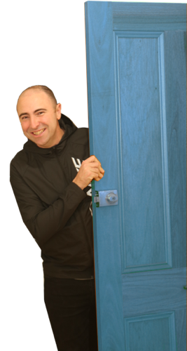 luke marshall entering through a blue door