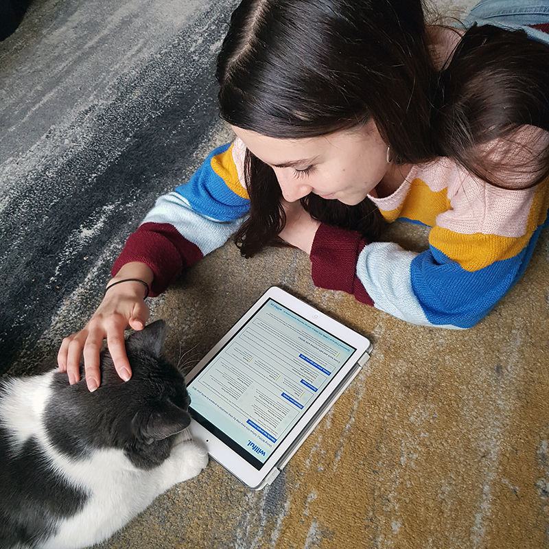 Woman and cat looking at checklist on a tablet